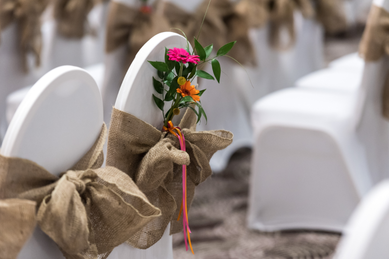 chair covers, brown fabric with flowers tied in